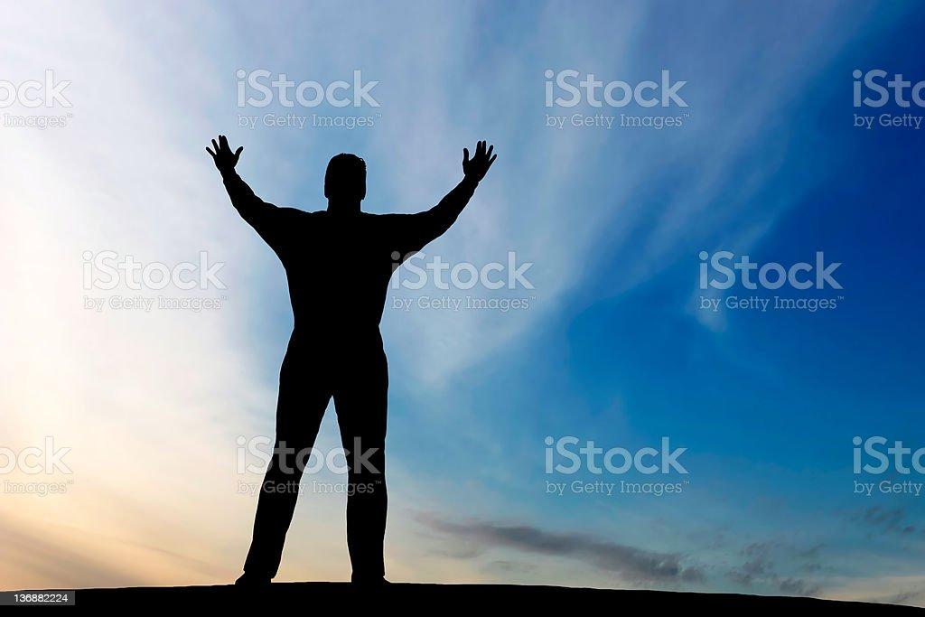 XXL reverent man silhouette royalty-free stock photo