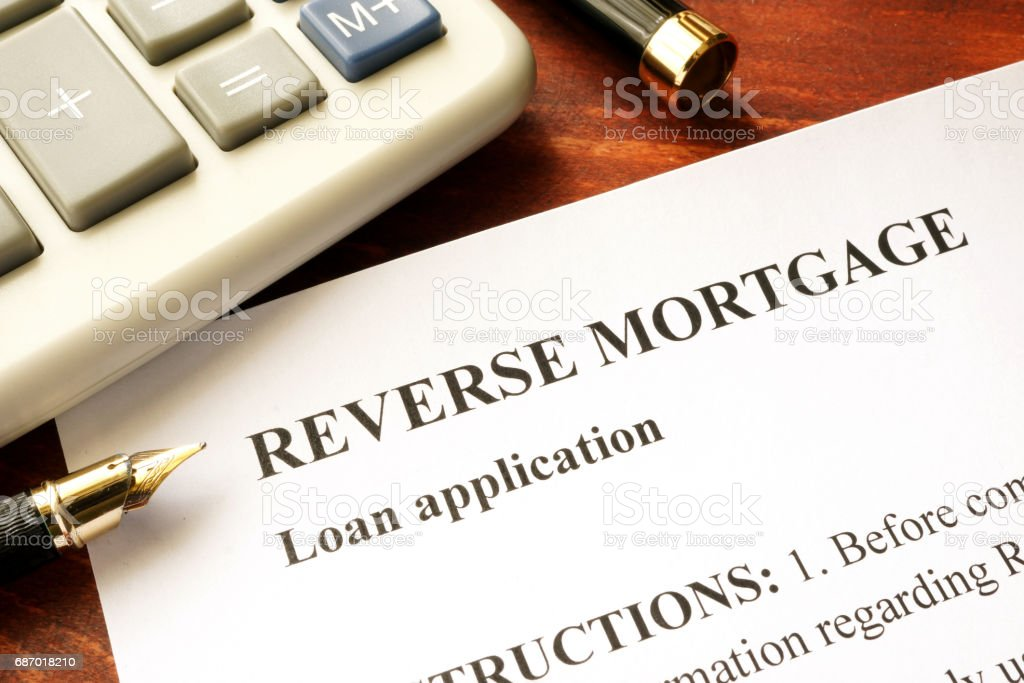 Reverse mortgage loan application on a table. stock photo