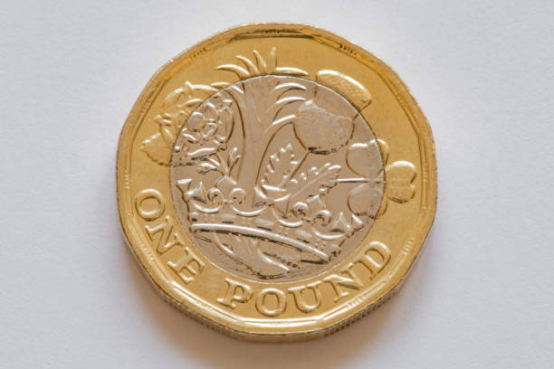 Reverse of the british coin one pound close-up Reverse of the british coin one pound close-up, isolated one pound coin stock pictures, royalty-free photos & images