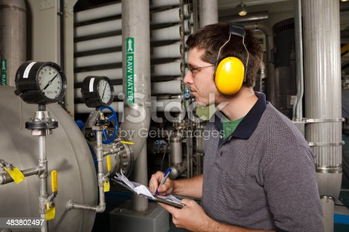 A technician in a reverse osmosis plant.