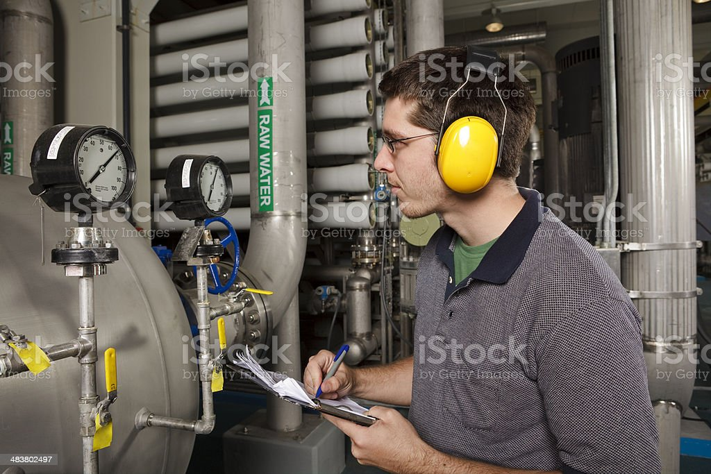 Reverse Osmosis Water Purification Plant Technician Checks System Settings stock photo