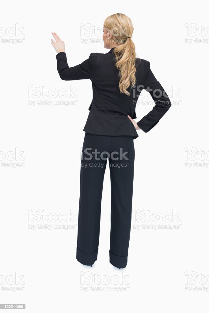 Reversed businesswoman showing something stock photo