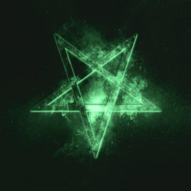 Reversed Pentagram symbol. Green symbol stock photo