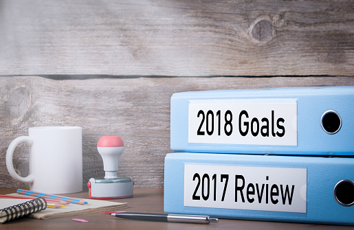 istock 2017 review and 2018 goals. Two binders on desk in the office. Business background 830124952