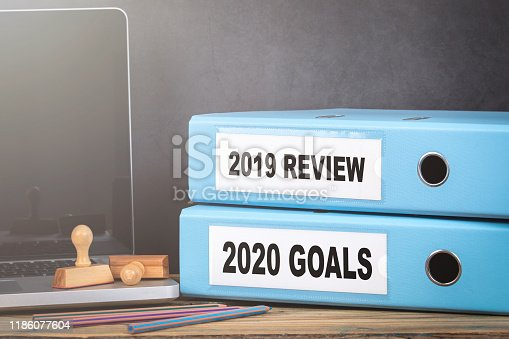 istock 2019 review and 2020 goal. Two binders on desk in the office 1186077604