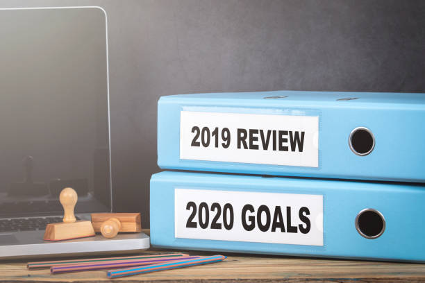2019 review and 2020 goal. Two binders on desk in the office stock photo