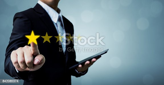 istock Review and rating increase company concept, Businessman hand touching five star 842085374