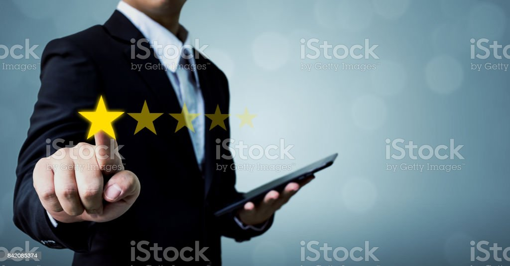 Review and rating increase company concept, Businessman hand touching five star stock photo