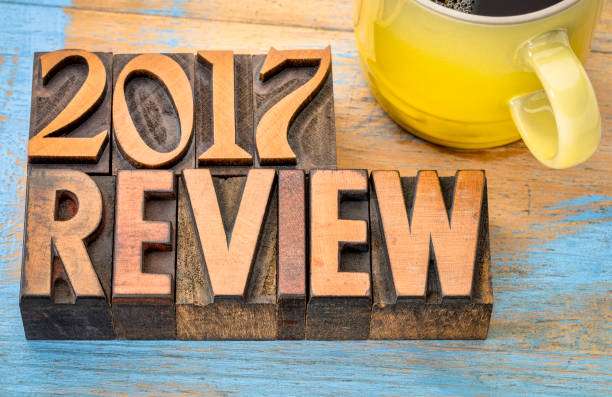2017 review banner in wood type 2017 year review banner - text in vintage letterpress wood type block with a cup of coffee 2017 stock pictures, royalty-free photos & images