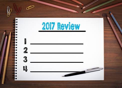 istock 2017 review blank list. Notebooks, pen and colored pencils on a wooden table. 862037060
