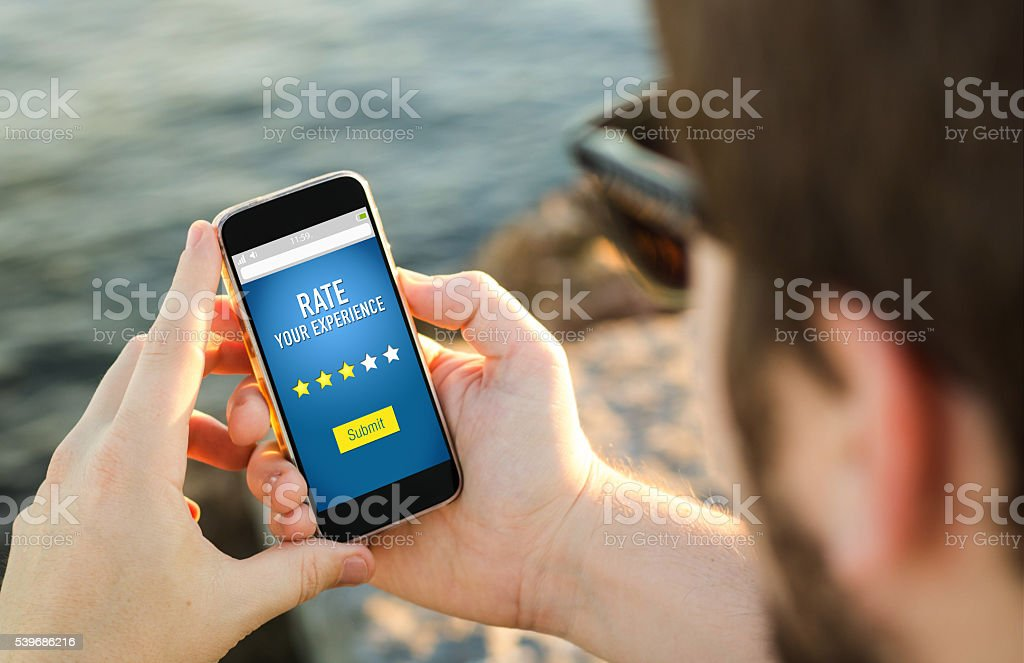 Review on mobile stock photo