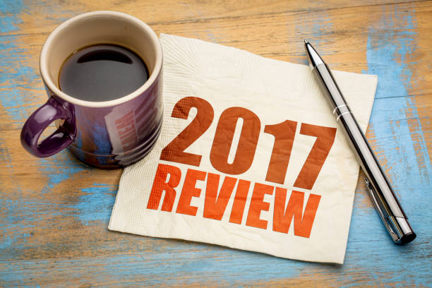 2017 review on napkin 2017 review text on a napkin with a cup of coffee 2017 stock pictures, royalty-free photos & images
