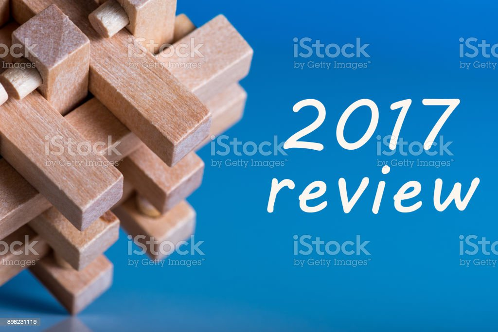 2017 review. Results of the Year. Note at blue surface near wooden brain teaser stock photo
