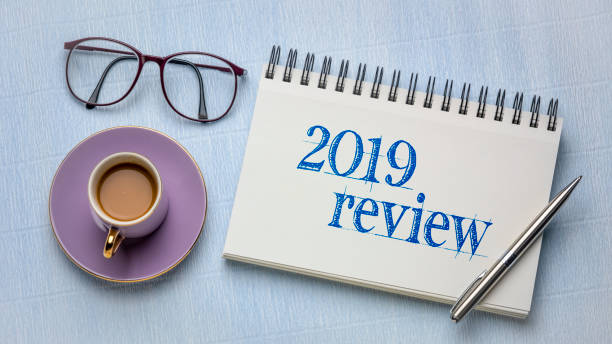 2019 review text in notebook stock photo