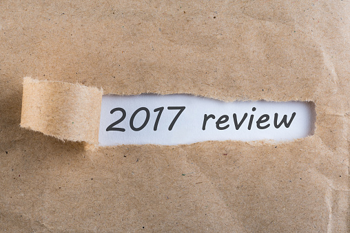 897644798 istock photo 2017 review - uncover letter. A passing year summary and review concept 897647652