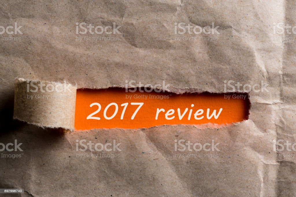2018 review uncovered envelope of brown paper with letter. The concept of achievements and failures of career and business at the Year stock photo