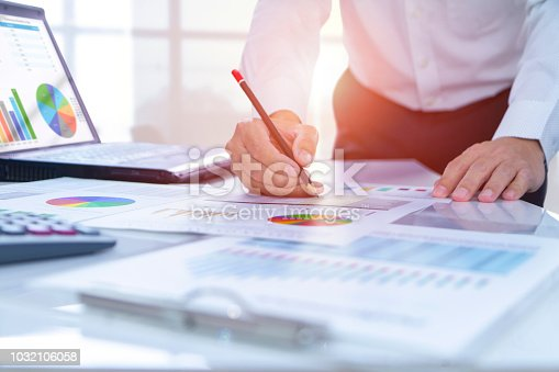 istock Reviewing a financial report in returning on investment analysis 1032106058