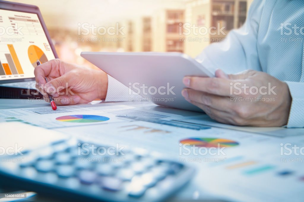Reviewing a financial report in returning on investment analysis stock photo