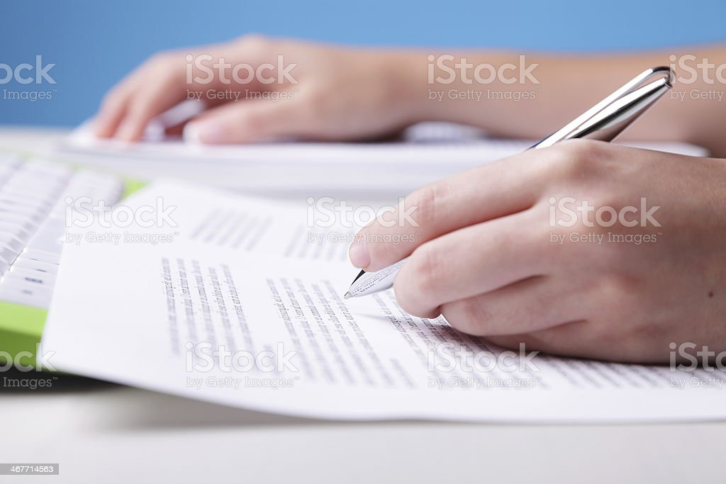 Reviewing a text royalty-free stock photo