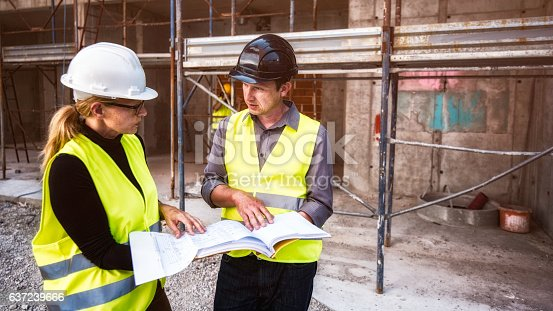istock Reviewing blueprints on a construction site 637239666