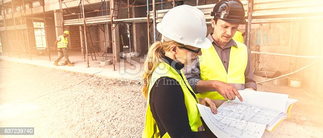istock Reviewing blueprints on a construction site 637239740