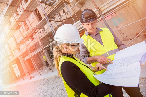 istock Reviewing blueprints on a construction site 637239780