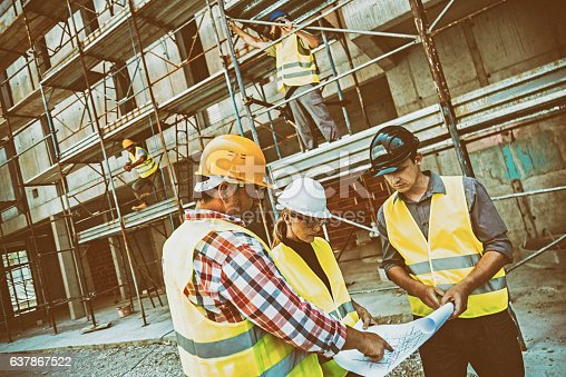 istock Reviewing blueprints on a construction site 637867522