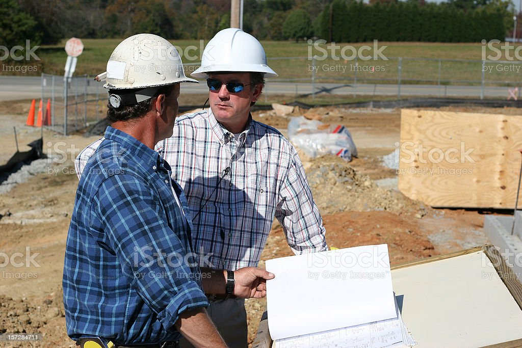 Reviewing Blueprints Together 3 royalty-free stock photo