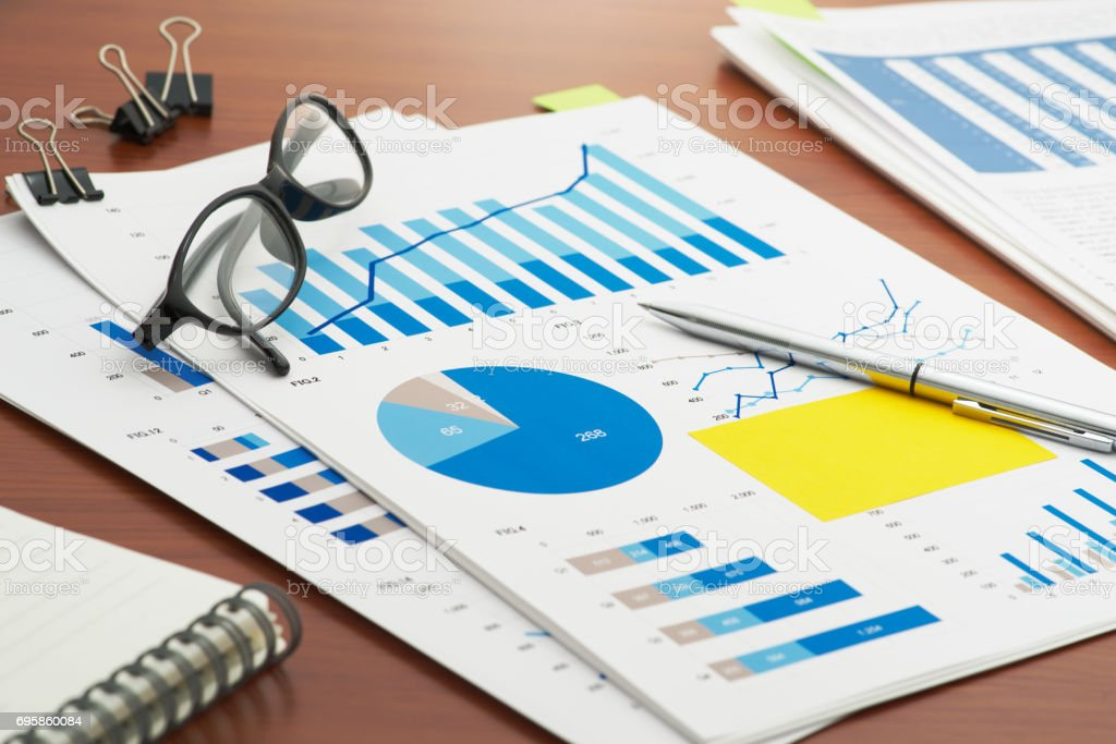Reviewing reports on business desk. stock photo