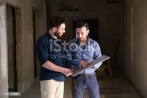 istock Reviewing tiles on a construction site 1161158961