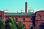 Revitalized red brick buildings. Retro colors stylization