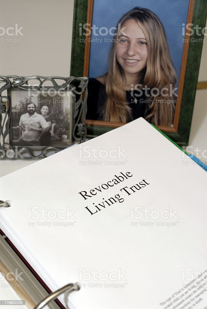 Revocable Living Trust documents with family pictures. royalty-free stock photo