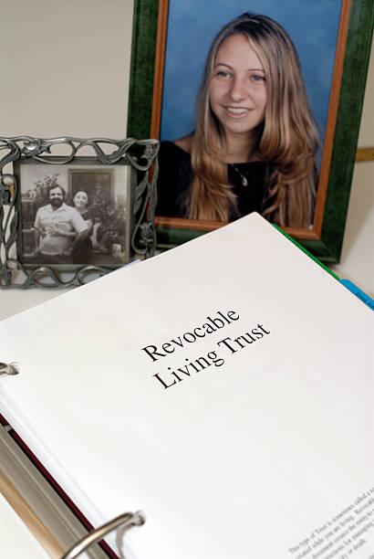 Revocable Living Trust documents with family pictures. stock photo