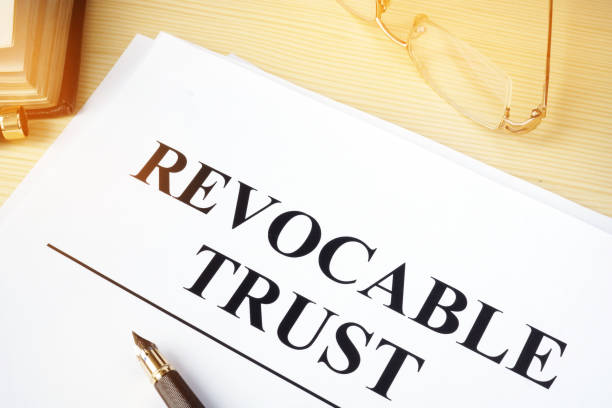 revocable trust on a wooden desk. - revocable trust stock pictures, royalty-free photos & images