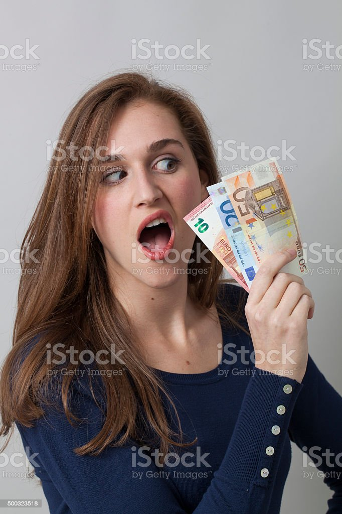 revolted young girl getting first paycheck or frustrated by investment stock photo