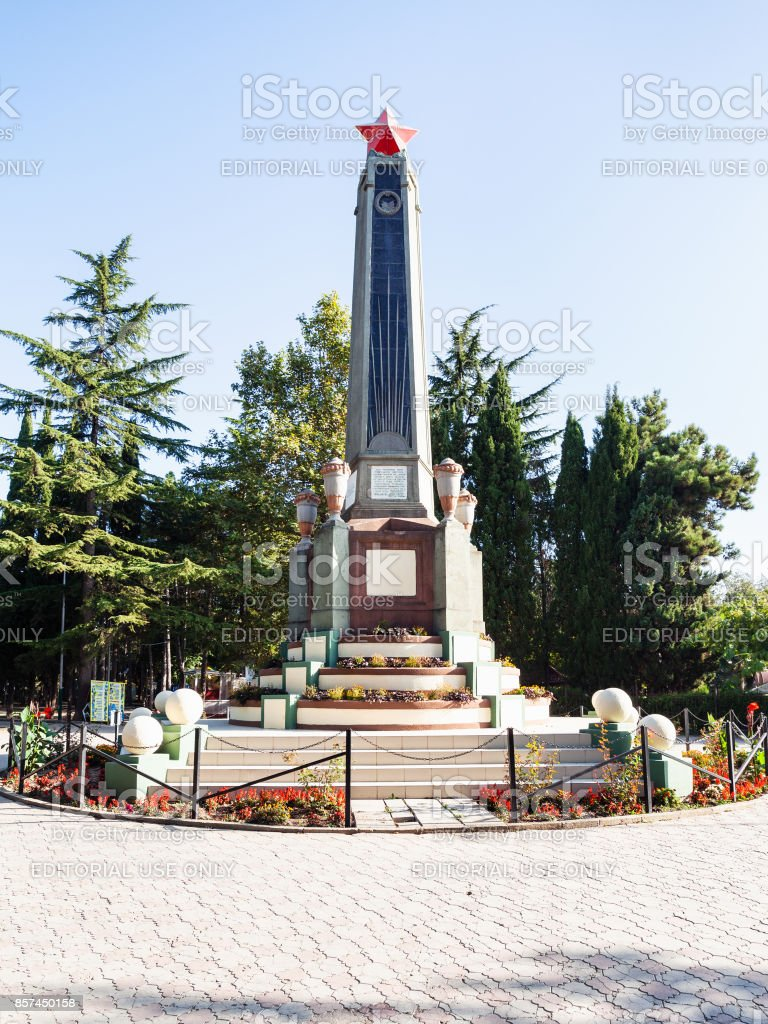 revolution stele in urban park in Alushta city stock photo