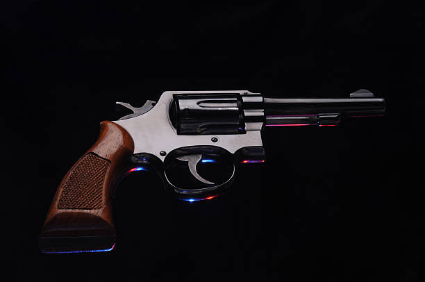 revolver against black background stock photo