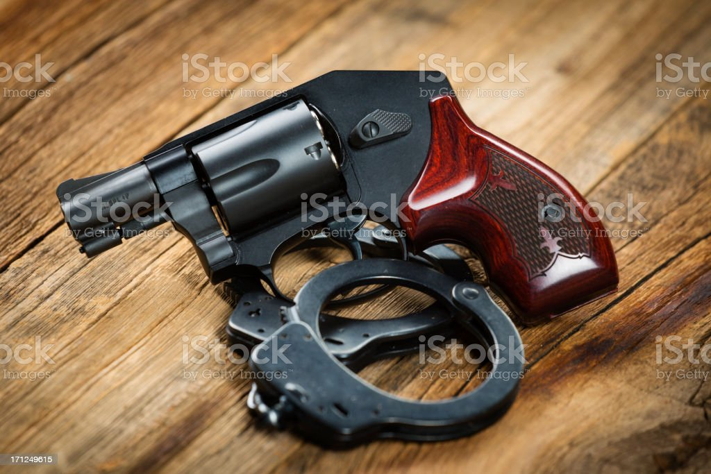Revolver and Handcuffs royalty-free stock photo
