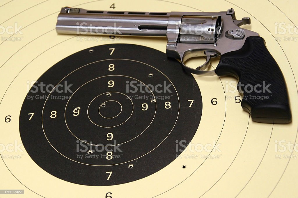 Revolver and target royalty-free stock photo