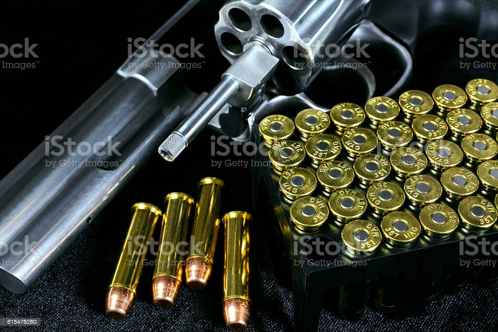 Revolver Gun With Open Cylinder And Ammo Cartridges Stock Photo