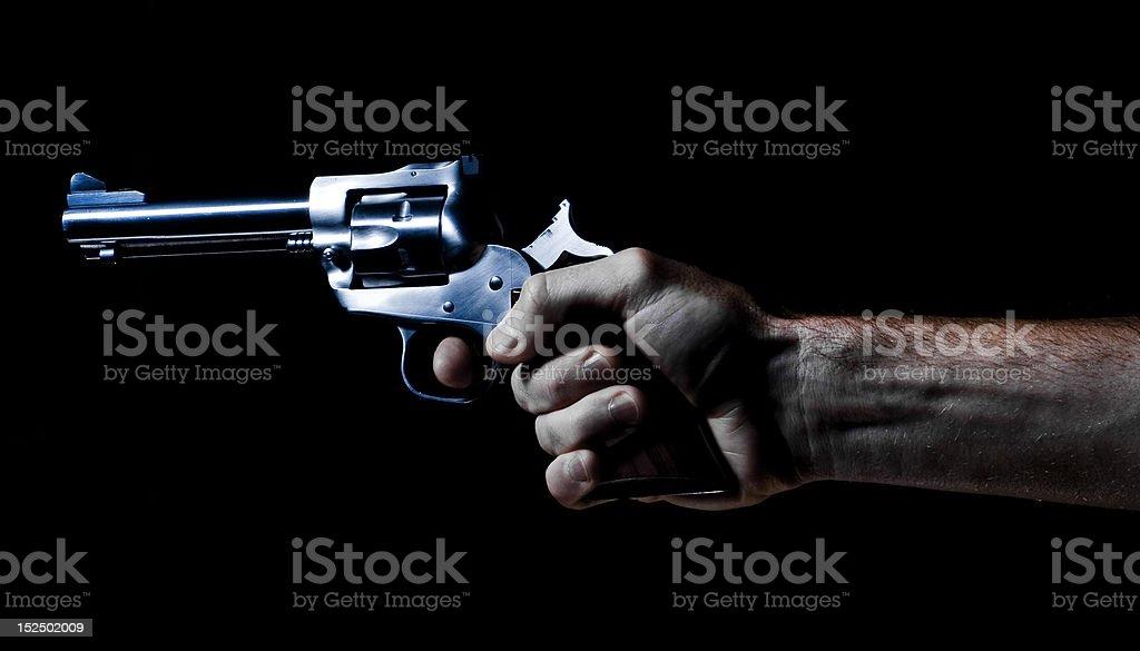 Revolver hand gun shooting royalty-free stock photo