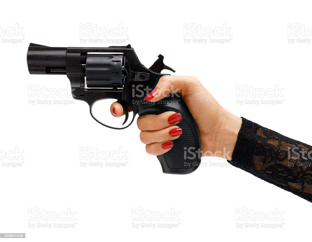 Revólver en la mano. - foto de stock