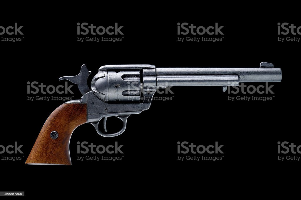 revolver pistol isolated on a black background stock photo
