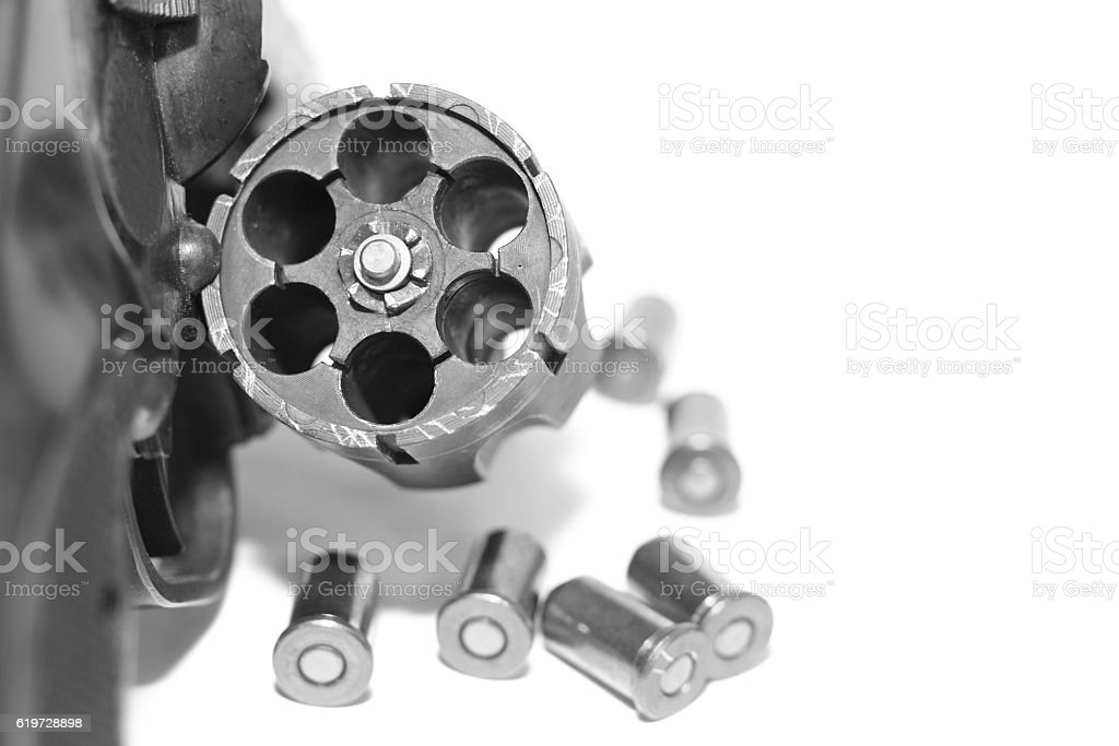 Revolver with bullets close-up isolated on white background - foto de stock
