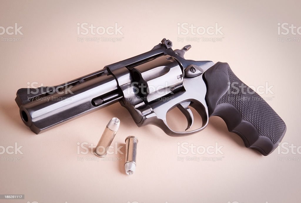 Revolver with bullets stock photo