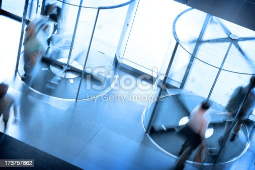 People going through a pair of revolving doors.Please see some similar pictures from my portfolio: