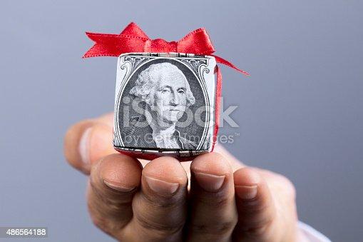 Money gift box in hand.
