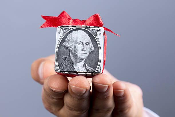 вознаграждение - dollar bill стоковые фото и изображения
