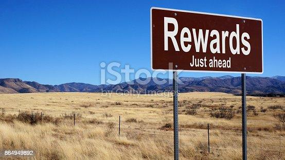 istock Rewards brown road sign 864949892