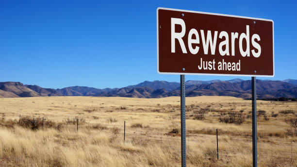 Rewards brown road sign Rewards brown road sign with blue sky and wilderness perks stock pictures, royalty-free photos & images